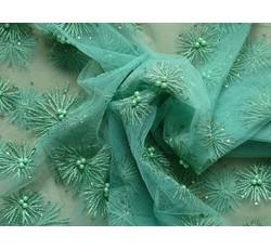 Tyly - elastický tyl 9683 se zelenými aplikacemi